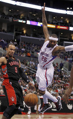 Toronto Raptors guard Jerryd Bayless knocks the ball out of the hands of Los Angeles Clippers guard Mo Williams during the first half of their NBA basketball game in Los Angeles