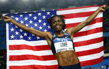 Lowe of the U.S. celebrates her gold medal at women's high jump final during the world indoor athletics championships in Istanbul