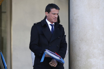 French Prime Minister Manuel Valls leaves the Elysee Palace following the weekly cabinet meeting in Paris