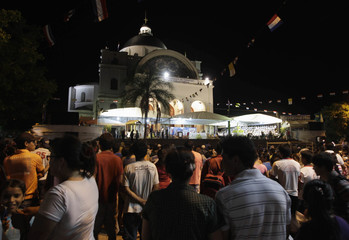 Catholics take part in a mass at the Caacupe cathedral, some 50 km (31 miles) east of Asuncion