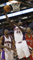 Suns' Stoudemire watches as Richardson goes to the basket against Trail Blazers' Camby during Game 1 of their NBA Western Conference playoff series in Phoenix