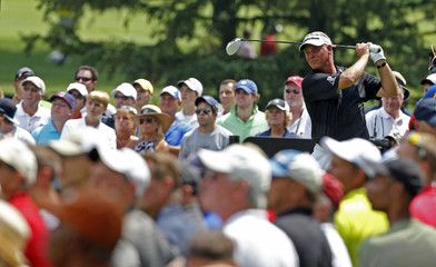 Northern Ireland's Darren Clarke tees off on the third hole during the first round of the WGC Bridgestone Invitational PGA golf tournament at Firestone Country Club in Akron