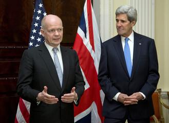 U.S. Secretary of State John Kerry listens to British Foreign Secretary William Hague speak during a news conference at Winfield House, the residence of the U.S. Ambassador to Britain, in London