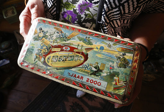 Dardenne shows a lithographed tin box dating from the 19th century, depicting how the world might look like in the year 2000, displayed at her house in Grand-Hallet