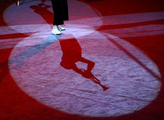 """A clown performs during the presentation of the new show """"The victors of arena"""" at the Belarus State Circus in Minsk"""