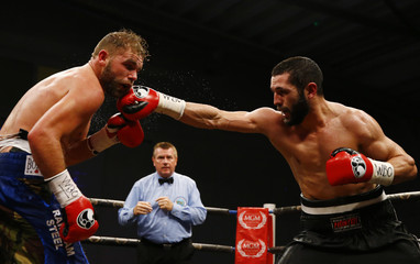 Billy Joe Saunders in action with Artur Akavov