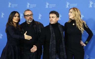"""Director de la Iglesia poses with cast members Hayek Bang and Mota during a photocall to promote the movie """"La Chispa de la Vida"""" at the 62nd Berlinale International Film Festival in Berlin"""