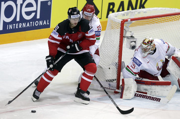 Canada's Spezza challenges Yevenko and goaltender Lalande of Belarus during their Ice Hockey World Championship quarterfinal game at the O2 arena in Prague