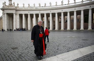 Cardinal Thomas Collins of Canada walks through Saint Peter's Square