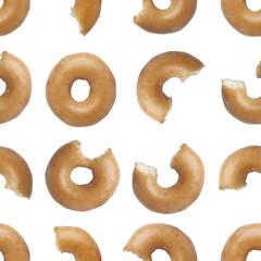 Seamless pattern of bites taken off a donut