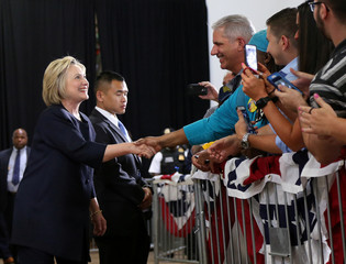Democratic U.S. presidential candidate Hillary Clinton shakes hands with supporters before speaking at a campaign rally in Cleveland