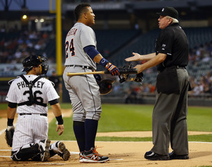 Tigers third baseman Cabrera yells at home plate umpire Gorman after being ejected in the first inning during MLB game against the White Sox in Chicago