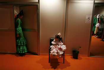 Models are seen backstage during the International Flamenco Fashion Show in Seville