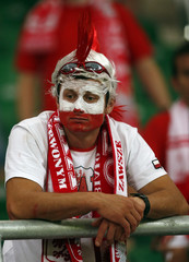 A Poland's fan reacts to his team's loss against Czech Republic after their Group A Euro 2012 soccer match at the City stadium in Wroclaw