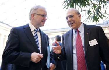 European Economic and Monetary Affairs Commissioner Rehn listens to Gurria, secretary-general of OECD, in Brussels