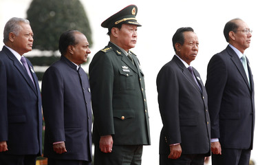 Defence ministers stand before the first ASEAN Defence Ministers Meeting Plus at the National Convention Center in Hanoi