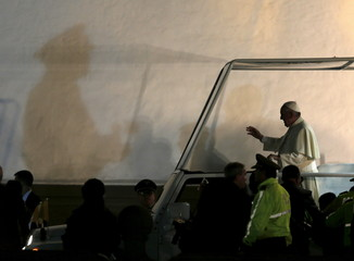 Pope Francis greets the faithful after a meeting with members of the civil society at the San Francisco Church in Quito