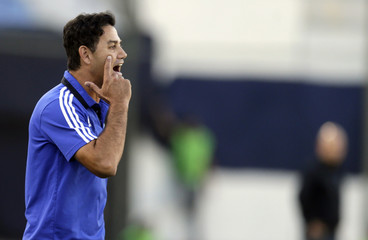 Daniel H. Ahmed, coach of Peru's Sporting Cristal, gestures during their Copa Libertadores soccer match against Paraguay's Guarani in Asuncion