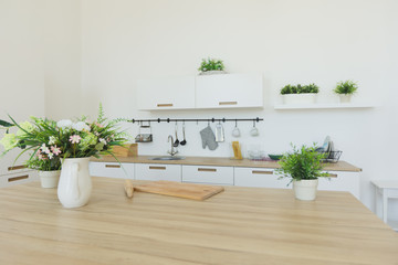 Bright kitchen background. The bright white kitchen. Wooden countertops