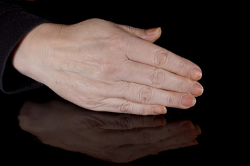Female hand and its reflection