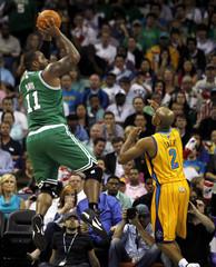 Boston Celtics center Glen Davis shoots over New Orleans Hornets guard Jarrett Jack during their NBA game in New Orleans