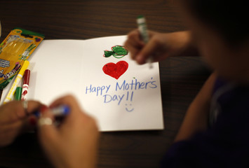 Children draw Mother's Day cards to take to their mothers at California Institute for Women state prison in Chino, California