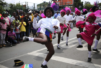 A girl dances on Vilakazi Street in Soweto, where the former South African President Nelson Mandela resided when he lived in the township