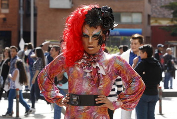 A reveller attends the annual gay pride parade in Bogota