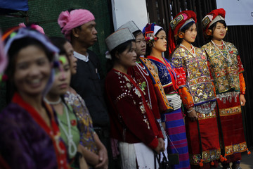 Congress delegates in ethnic costumes pose for a photo before attending the National League for Democracy's congress in Yangon