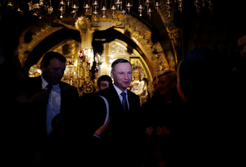 Polish President Andrzej Duda and his wife Agata Kornhauser-Duda visit the Church of the Holy Sepulchre in Jerusalem's Old City