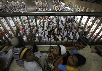 """Children attend mass prayer session """"Tarawih"""", which marks the beginning of the holy fasting month of Ramadan, at Istiqlal mosque in Jakarta"""