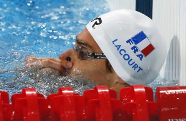 Lacourt of France removes nose clip after men's 50m backstrocke heats at the Aquatics World Championships in Kazan