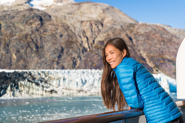 Wall Mural - Alaska cruise ship tourist looking at glacier front in Glacier Bay National Park, USA. Woman on travel vacation sailing enjoying view of Margerie Glacier.