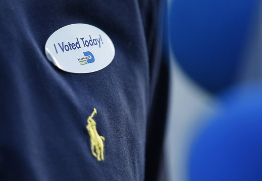 A sticker is spotted on the shirt of Republican U.S. Senate candidate Marco Rubio after he cast his ballot in Miami