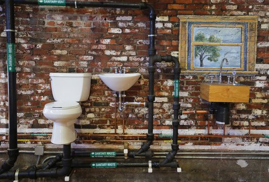 Common set-up for modern, indoor plumbing with a toilet and sink is displayed at The Plumbing Museum in Watertown