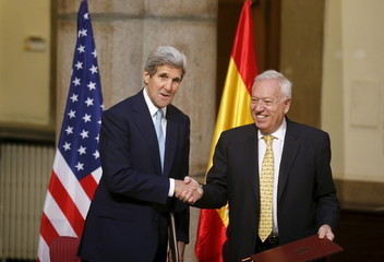 U.S. Secretary of State John Kerry and Spanish Foreign Minister Jose Manuel Garcia-Margallo shake hands after signing an agreement at the Foreign Ministry in Madrid, Spain