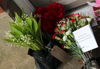 Tributes are seen outside the house of singer George Michael, where he died on Christmas Day, in Goring, southern England