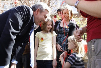 Britain's Prime Minister Gordon Brown and his wife Sarah talk to Labour supporters in Bedford