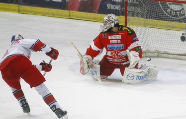 Raffl of Red Bull Salzburg scores a goal past KAC's Chiodo during their sixth match of the best of seven final series of the Austrian Ice Hockey League playoffs in Salzburg
