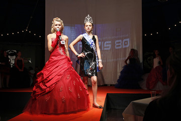 "A contestant at the ""Mini-Miss"" elegance beauty contest presents herself to the judges in Bobigny"