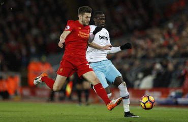 Liverpool's Adam Lallana in action with West Ham United's Pedro Obiang