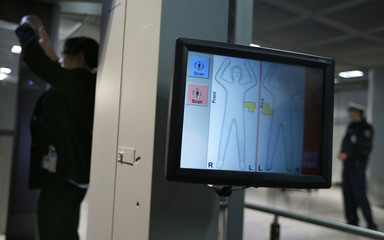 German border police press spokeswomen is scanned in a body scanner at Fraport airport in Frankfurt