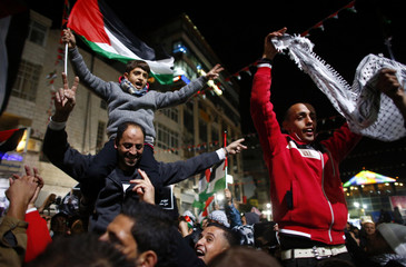 Palestinians shout slogans during a rally in the West Bank city of Ramallah