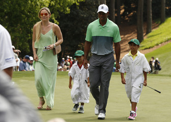 Vonn walks with U.S. golfer Woods and his children Sam and Charlie during the par 3 event held ahead of the 2015 Masters at Augusta National Golf Course in Augusta