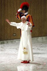 Pope Benedict XVI waves as he leaves after an audience with Members of the Gypsy communities drawn from all over Europe at the Vatican