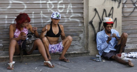 Drug users prepare pipes of crack, in part of Sao Paulo's Luz neighborhood known to locals as Cracolandia