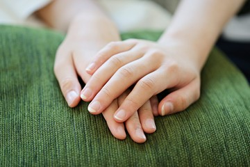 People sitting with hands clasped concept soft focus background