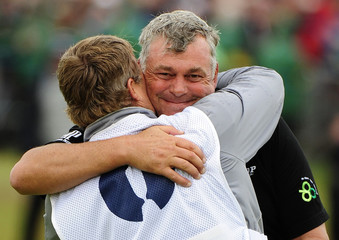 Darren Clarke of Northern Ireland hugs his caddie John Mulrooney after winning the British Open golf championship at Royal St George's in Sandwich