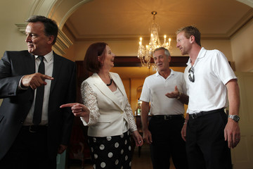 Australia's Prime Minister Gillard and her partner Mathieson welcome England's Collingwood to an afternoon tea for Ashes team members in Sydney