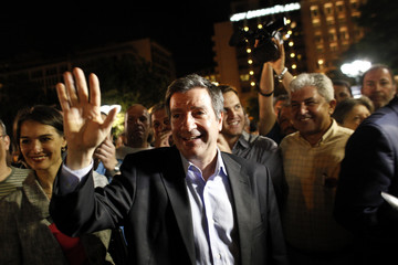Re-elected Mayor of Athens Kaminis waves to supporters at Syntagma square in Athens